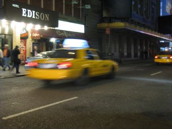 1280px-NYC_Taxi_in_motion